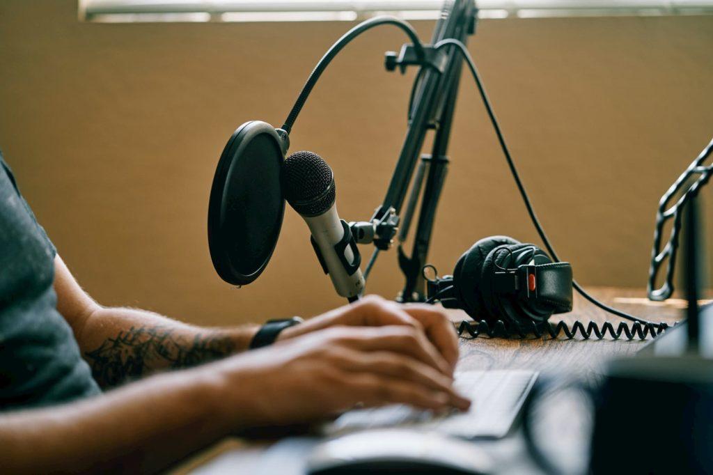 Podcast-Producer-At-Desk
